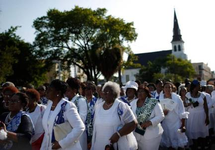 From the Charlotte Observer, mourners gathering at South Carolina State senator and Rev. Clementa Pinckney's funeral.