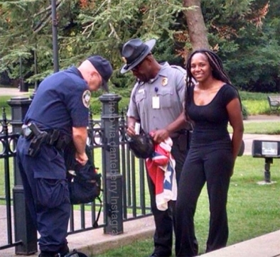 Bree Newsome being arrested after she peacefully removed the Confederate flag from its place in front of the South Carolina State House.